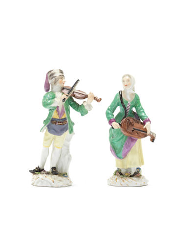 A pair of Meissen 'Cris de Paris' figures of a ballad seller and a female hurdy gurdy player, circa 1753-54