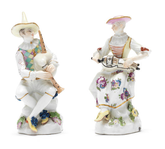 A pair of Meissen figures of Harlequin playing the bagpipes and Columbine playing a hurdy-gurdy, mid 18th century