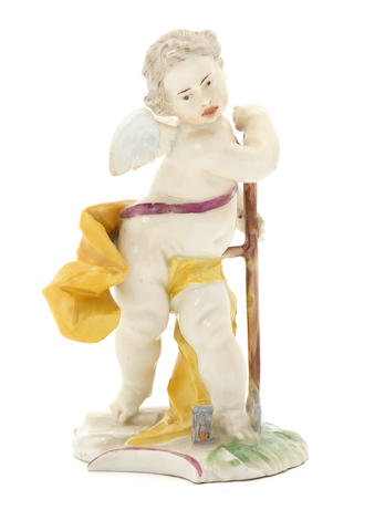 A Nymphenburg figure of a putto as Saturn from the series of Ovidian Gods, late 18th century