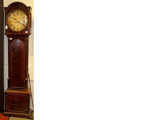 An early 19th century mahogany longcase clock  The circular enamel dial signed T.J. Upjohn, London