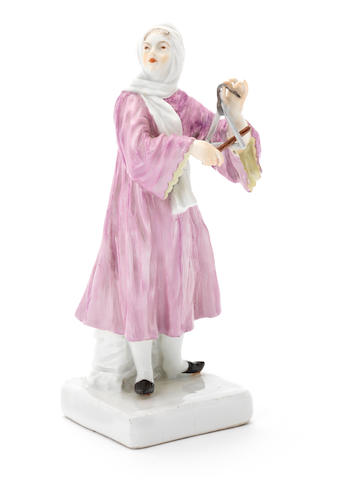 A Meissen figure of a lady playing a triangle (handsand triangle restored)