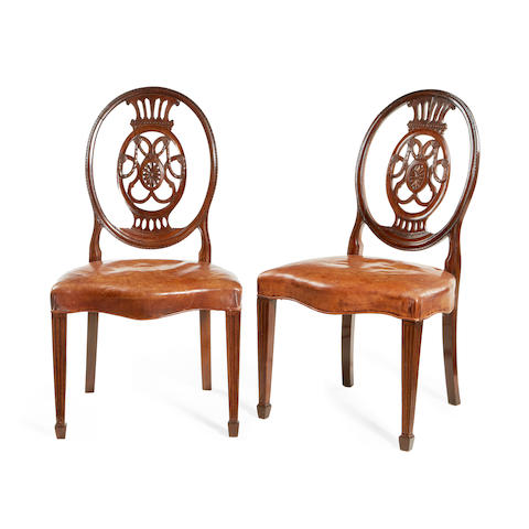 A set of eight late Victorian dining chairs in the Hepplewhite style