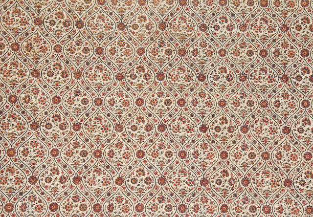 A printed length of cotton for the Persian or Thai market with ogival panels with flowers and gold India, late 19th Century