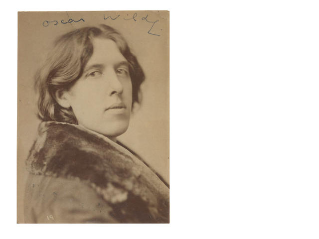 WILDE (OSCAR) Portrait by Napoleon Sarony, albumen print, SIGNED AT THE HEAD BY WILDE, 1882