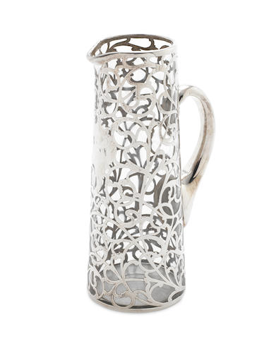 A silver overlay glass water jug possibly American, together with three sauce boats, a French asparagus server, seven assorted teaspoons and an Old English pattern sauce ladle  (13)
