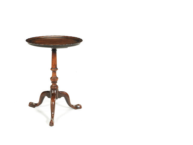 A  George III mahogany and brass inlaid tripod table