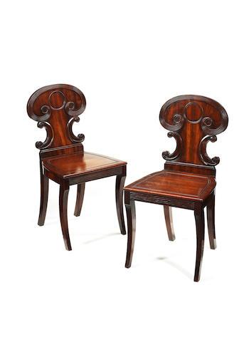 A pair of Regency mahogany hall chairs