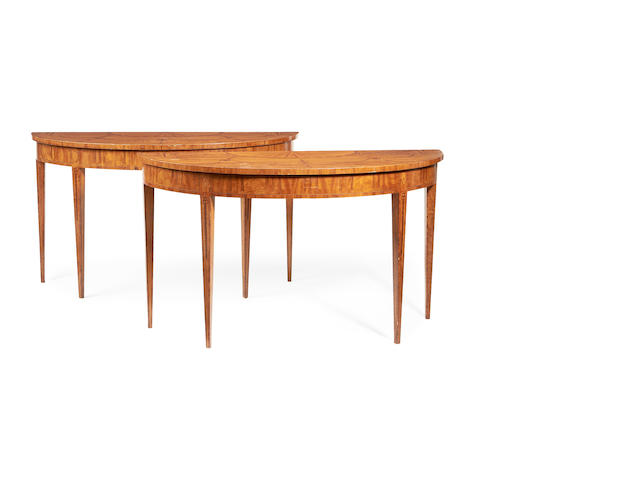 A pair of satinwood, rosewood banded and fruitwood marquetry demi lune tables  in the George III style