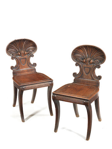 A pair of Regency carved mahogany hall chairs possibly by Anderton for Gillows