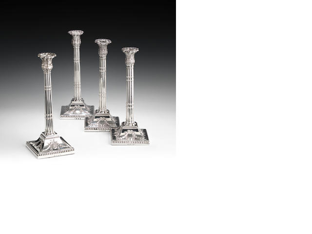 A matched set of four George III silver cluster column candlesticks, London 1772 and Sheffield 1773