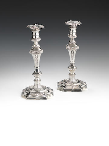 A pair of silver cast candlesticks by Robert Garrard, London 1851 & 1856. Weight 74 ozs.