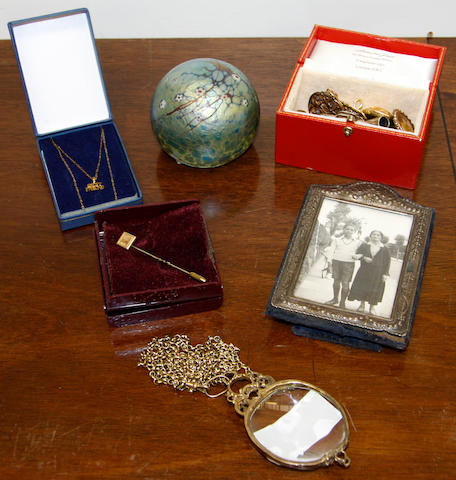 A Cartier photo frame, a Tiffany & Co silver novelty pill box and others