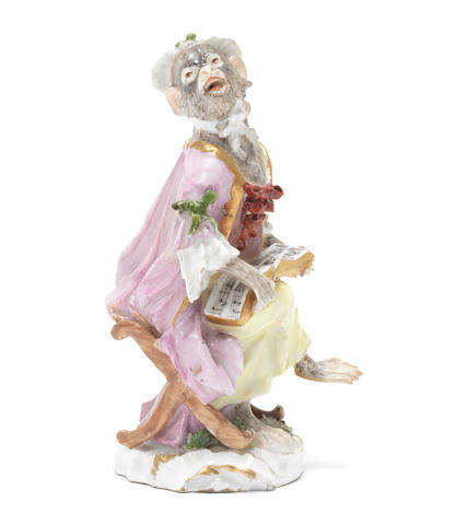 A Meissen monkey band figure of a seated female singer, third quarter 18th century