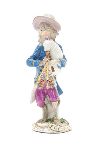 A Meissen monkeyband figure of a bagpipe player third quarter of the 18th century (both hands, pipe and corner of rococo base as well as corner of his jacket and the edge og his hat restored) (Valuation Ref 305646/17)