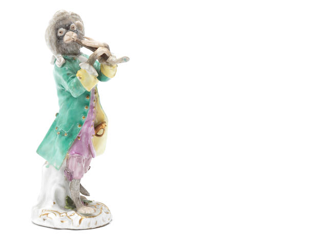 A Meissen monkeyband figure of a flautist third quarter 18th century Dressed in a green coat (flute and right hand restored, smaller losses and flakes to enamel coloures) (Valuation Ref 305646/1)