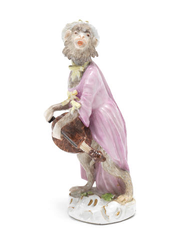 A Meissen monkey band figure of a female hurdy-gurdy player, third quarter 18th century