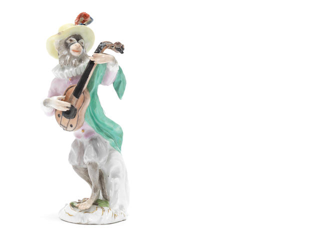 A Meissen monkeyband figure of a guitar player third quarter of the 18th century (left hand and neck of instrument restored, plume on hat restored) (Valuation Ref 305646/5)