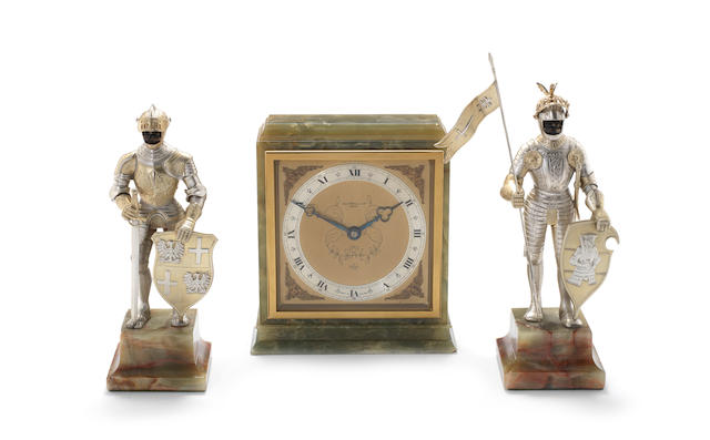 A pair of silver  clock garnitures, modelled as knights with an onyx clock the knights with import marks for Israel Freeman & Son Ltd, London 1969  (3)