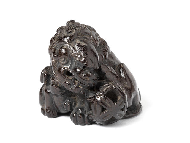 An ebony netsuke of a shishi and cub By Sato Masayoshi, 19th century