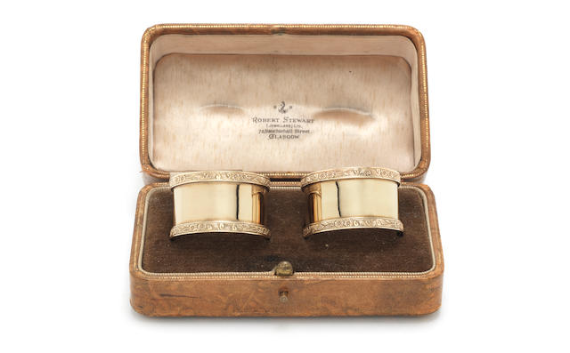 A cased pair of 9 carat gold  napkins rings by A Wilcox, Birmingham 1958