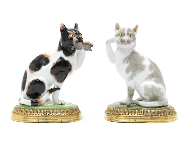 A pair of Meissen models of cats with gilt metal mounts