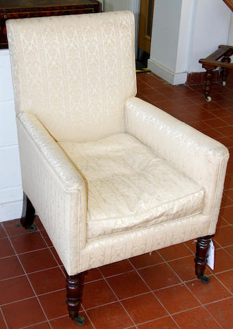 A small Victorian Armchair on turned legs and casters