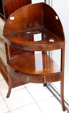 A George III mahogany bowfront corner washstand