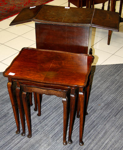 A Queen Anne style mahogany nest of three tables