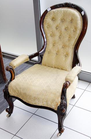 A Victorian mahogany spoonback armchair