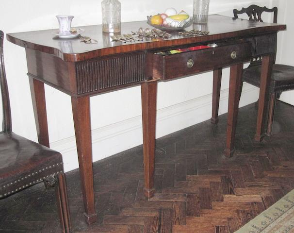 A 19th century mahogany serpentine serving table