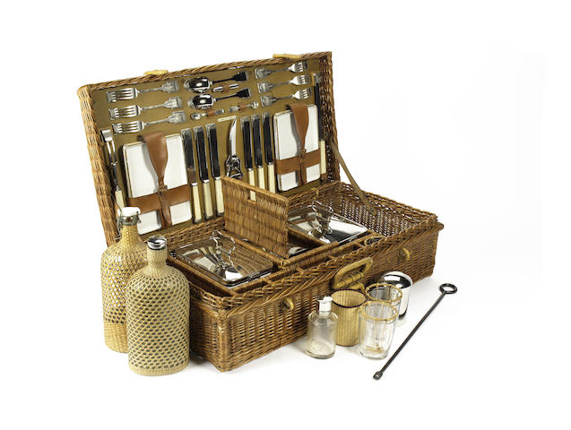 A six person wicker picnic basket for Harrods, circa 1909,