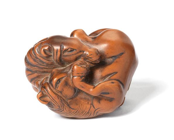 A rare early boxwood netsuke of two horses By Awataguchi, Edo, 18th century
