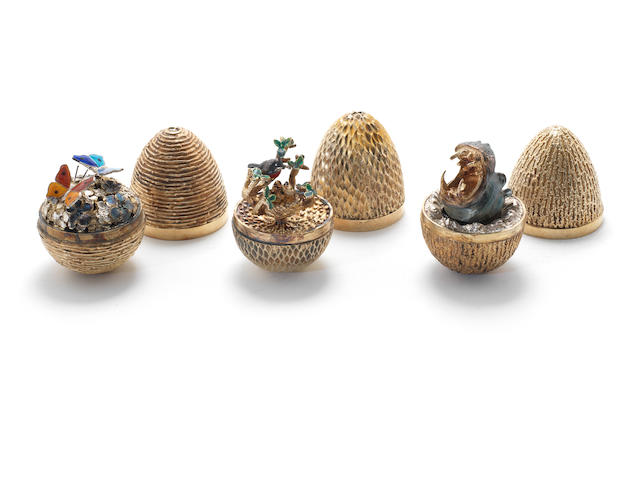 STUART DEVLIN: a silver-gilt and enamel surprise egg numbered 68, London 1973 with two further examples (3)