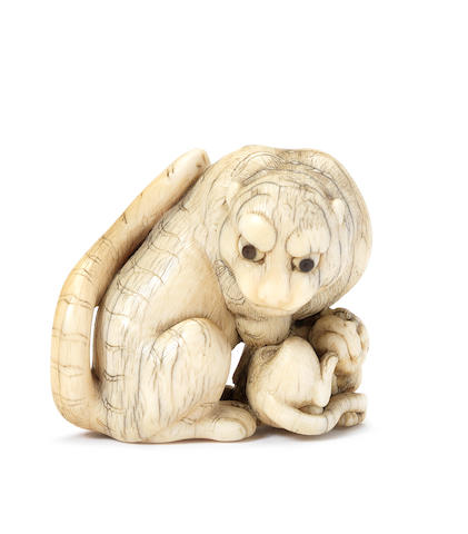 An ivory netsuke of a tigress and cub Style of Tomotada, Kyoto, 18th century