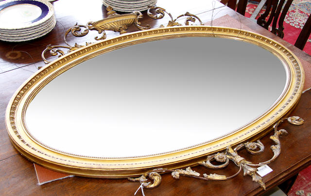 A Victorian gilt gesso oval mirror