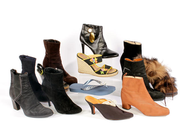 A quantity of designer shoes and boots, including Louis Vuitton, Yves Saint Laurent and Dolce and Gabbana