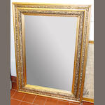 An Austrian Art Nouveau giltwood and composition mirror,