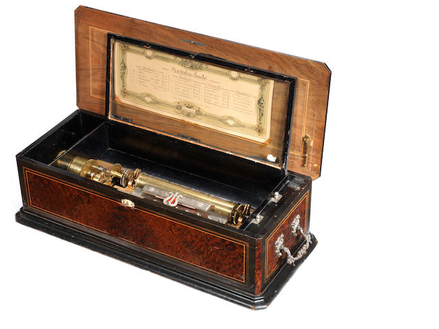 A cylinder music box by Barker-Troll,in thuya case with three extra cylinders, originally on a stand, only the drawer remaining.
