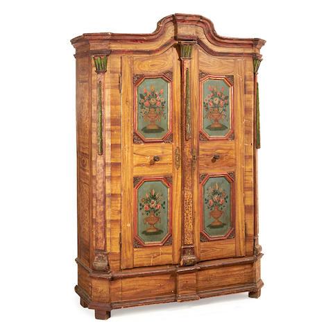 An Austrian early 19th century polychrome decorated wardrobe