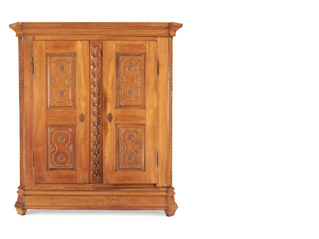 An early 19th century cherrywood wardrobe/armoire