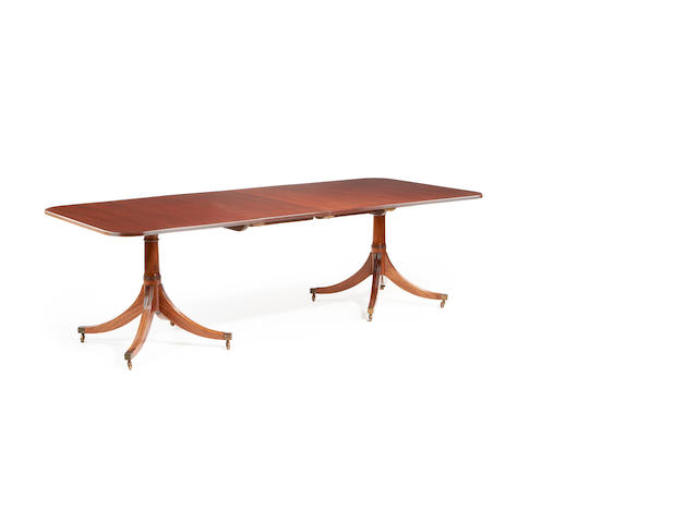 A George III style mahogany dining table by William Tillman