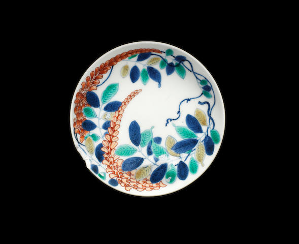 A Nabeshima small enamelled dish, wisteria branch (chipped)