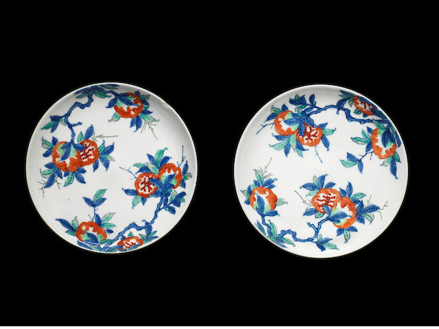A pair of Nabeshima saucer dishes, two pomegranate branches