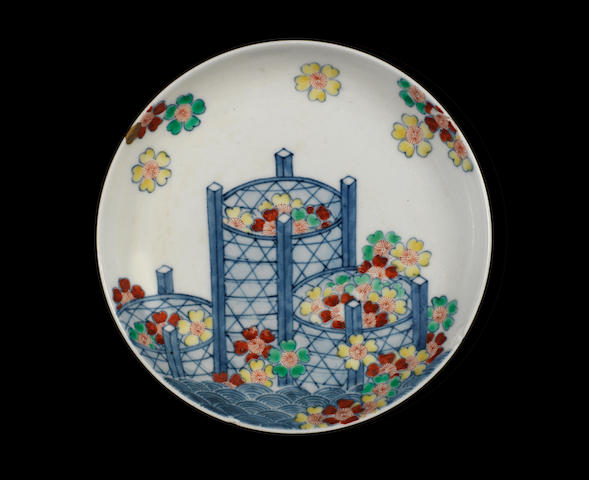 A Nabeshima saucer dish (enamels added later), three baskets with flowers