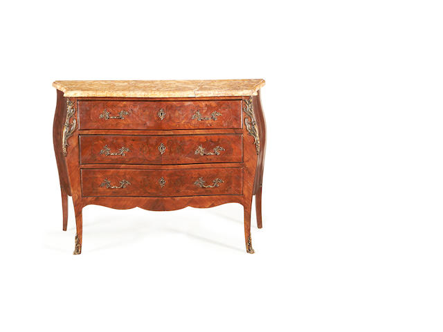 A French late 19th/early 20th century brass mounted marquetry serpentine commode in the Louis XV style