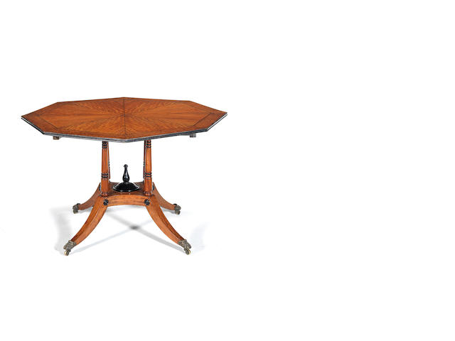 A satinwood octagonal tilt-top table