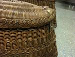 A pair of shaped wicker panniers for a veteran car,