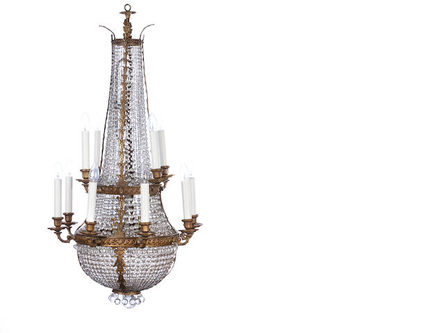 An Edwardian brass framed twelve light basket chandelier