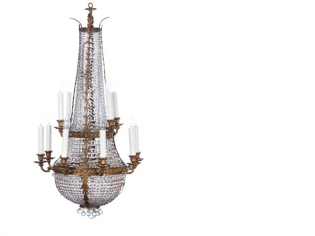 An Edwardian brass framed twelve light basket chandelier