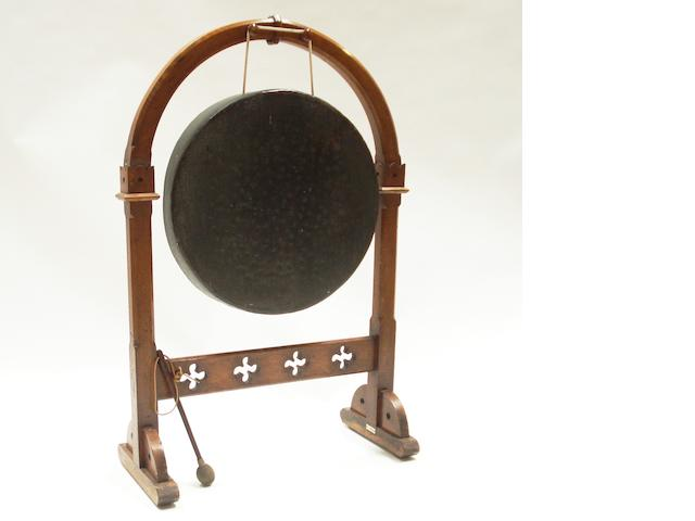 A Victorian Gothic style carved oak gong and stand